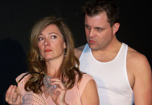 """Mark Kuntz and Cara Wilder tackle Stanley Kowalski and Blanche DuBois in Tennessee Williams' classic """"A Streetcar Named Desire"""" at The Ellen Theatre."""