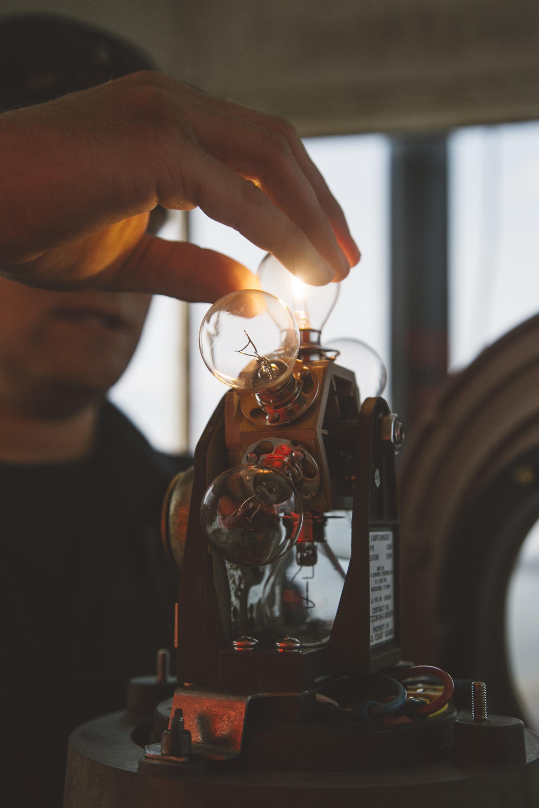Em1 Tony Robb fixes a light at Spring Point Ledge Light.        Photo © Jenny Rebecca Nelson