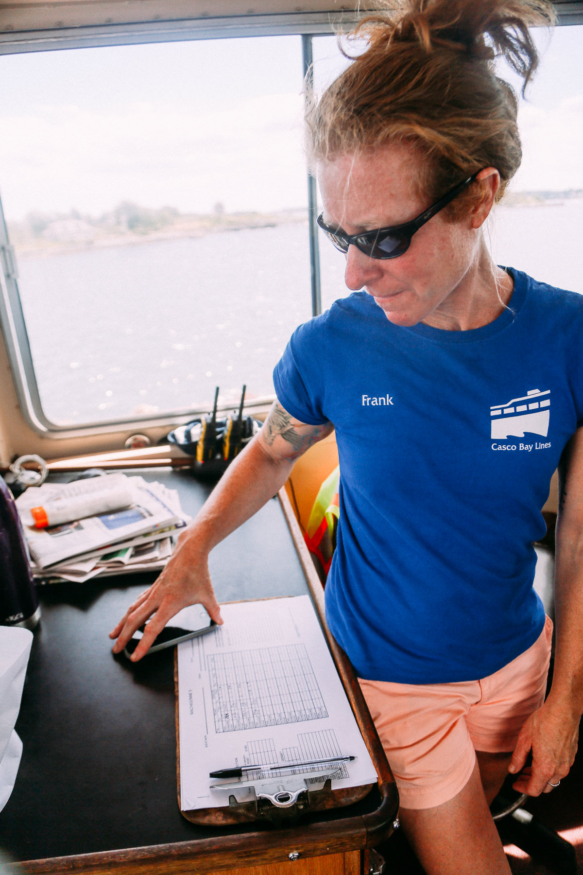 Gretchen Frank looks at the Machigonne II log book. Photo by Justin Levesque © 2016.