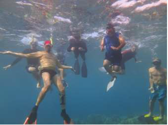 Mayor Alan Arakawa (in blue) tours a Ka'anapali reef to increase first-hand experience of marine degradation.