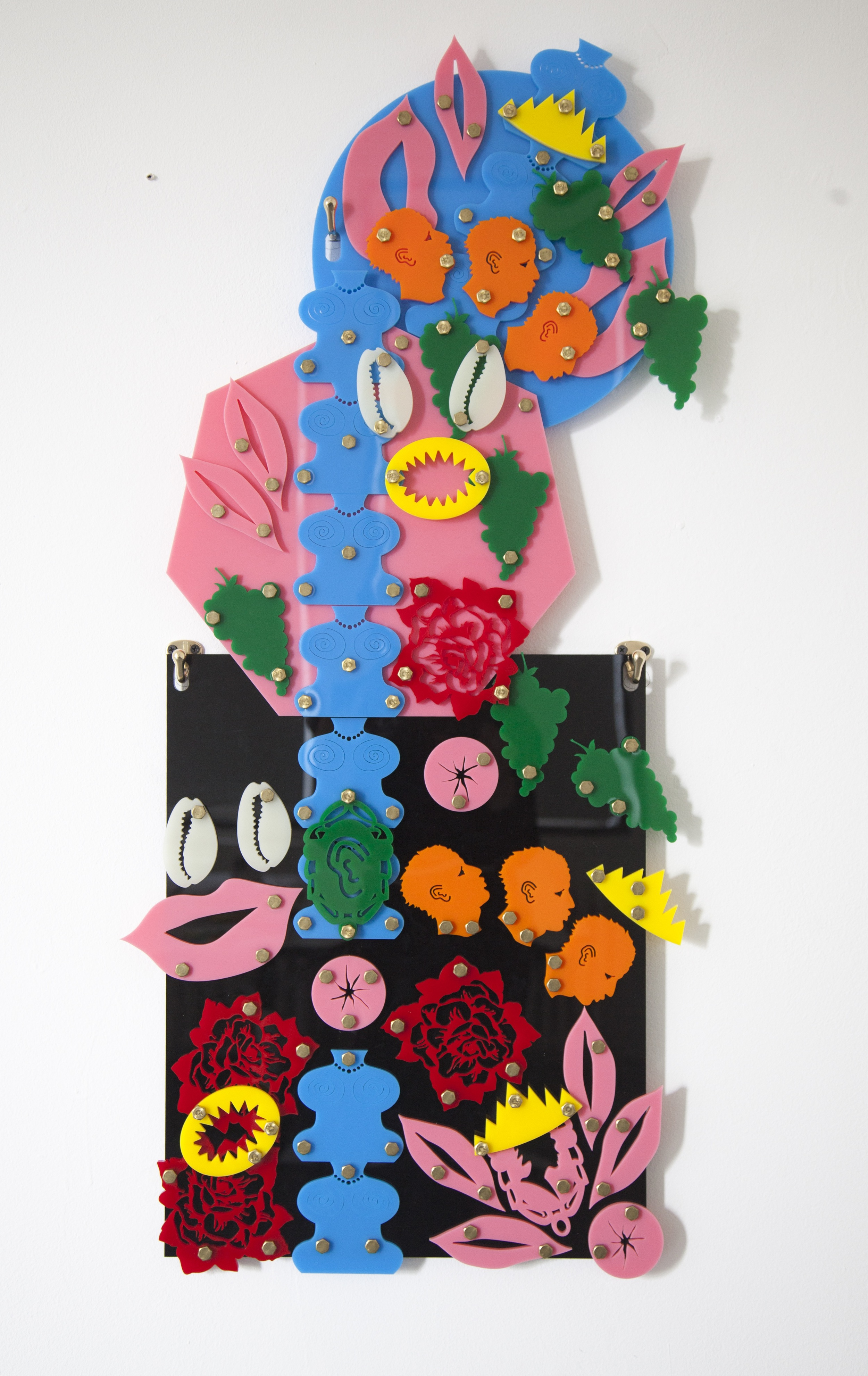 Tower of Hips  (Blackamoors Collage #9), 2014  Plexiglass and brass  19.5 x 41 inches