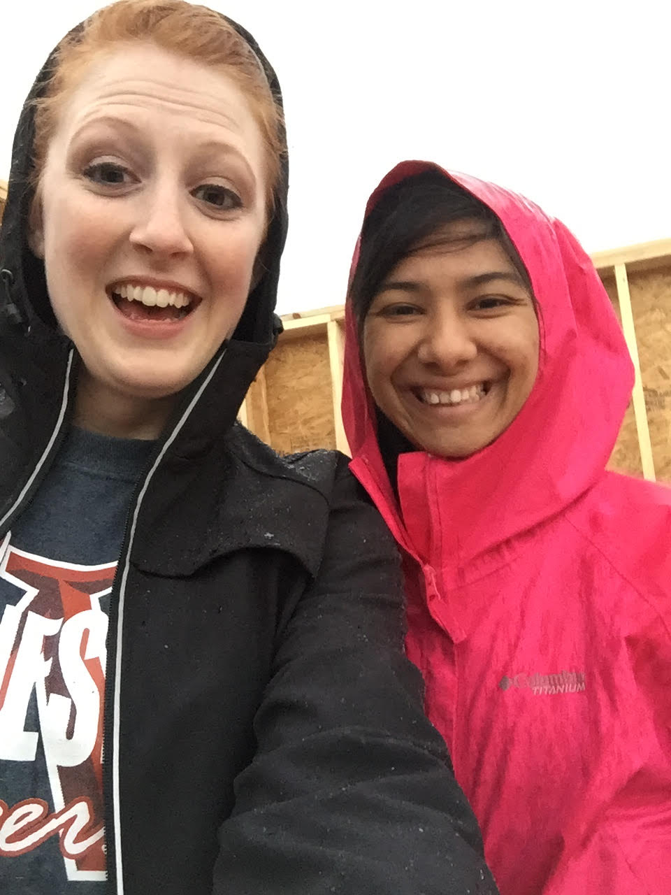 Katelyn and Anna trying to stay dry from the rain.