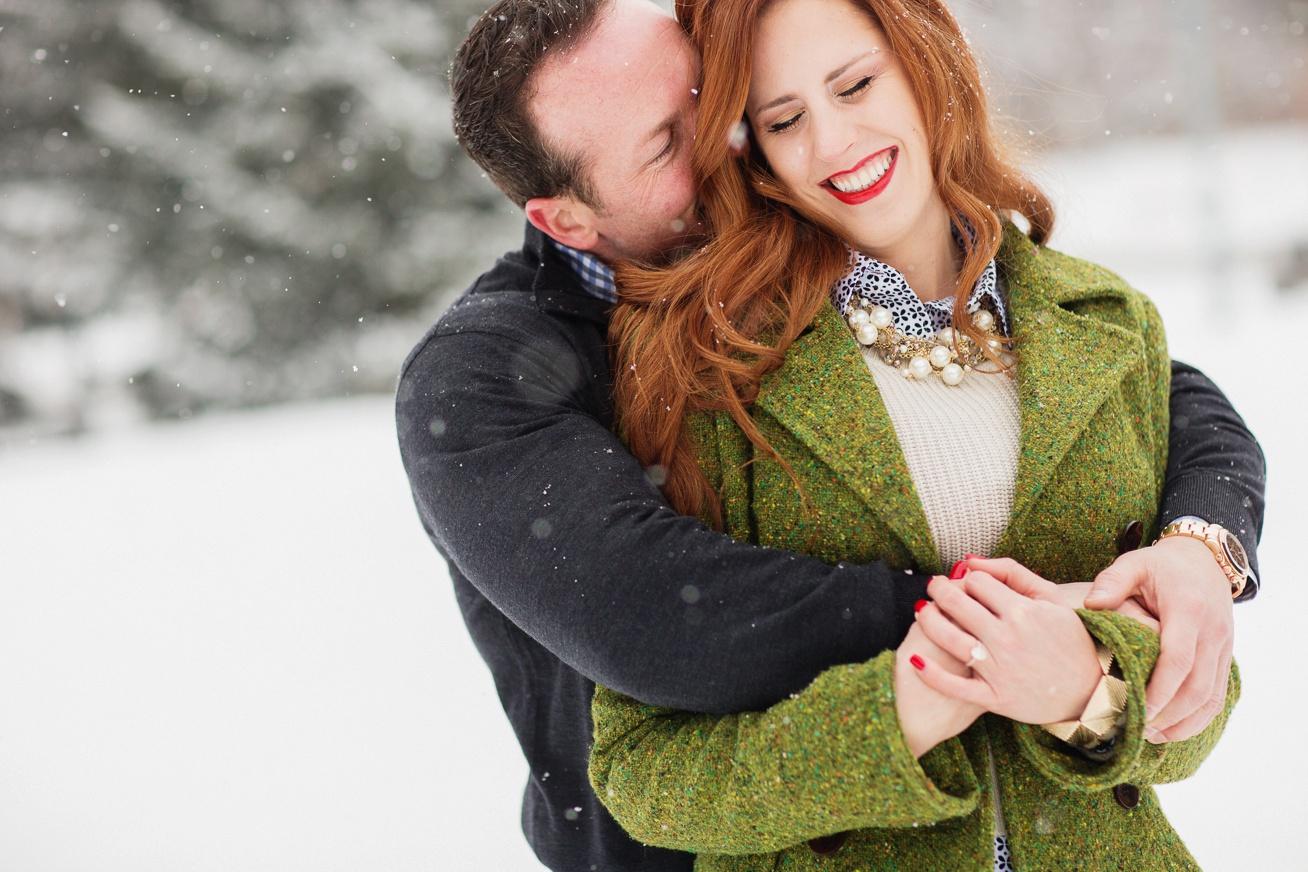 Aspen Engagement Couple in snow / Aspen wedding Photographer Cat Mayer Studio