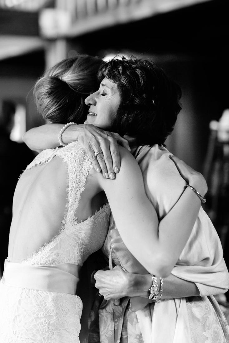 Bride hugging her mom