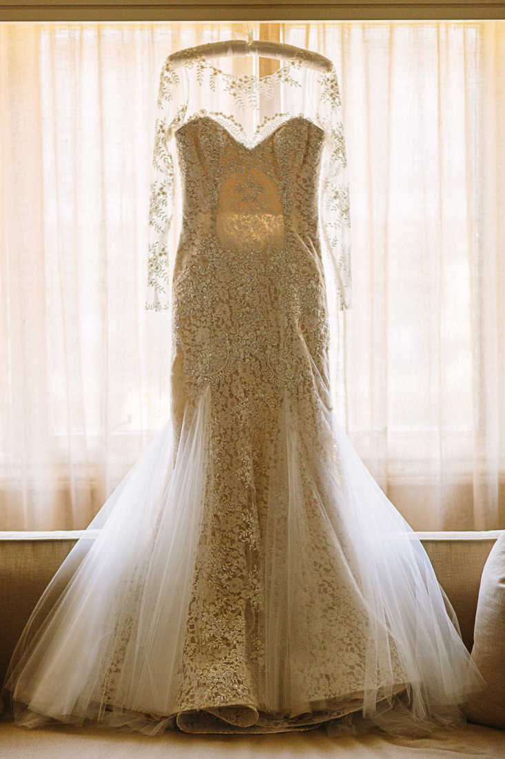 Kristina's couture dress made by Nha Khahn from her grandmother's 75-year-old lace wedding gown