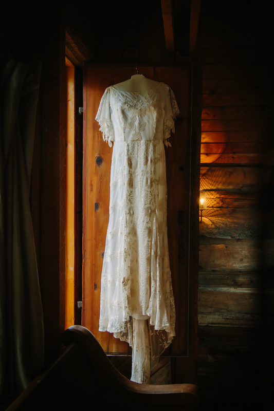 Lace wedding dress hanging in doorway | Design: Rue de Seine | A&Be Bridal Denver | Telluride Wedding Photographer | Cat Mayer Studio