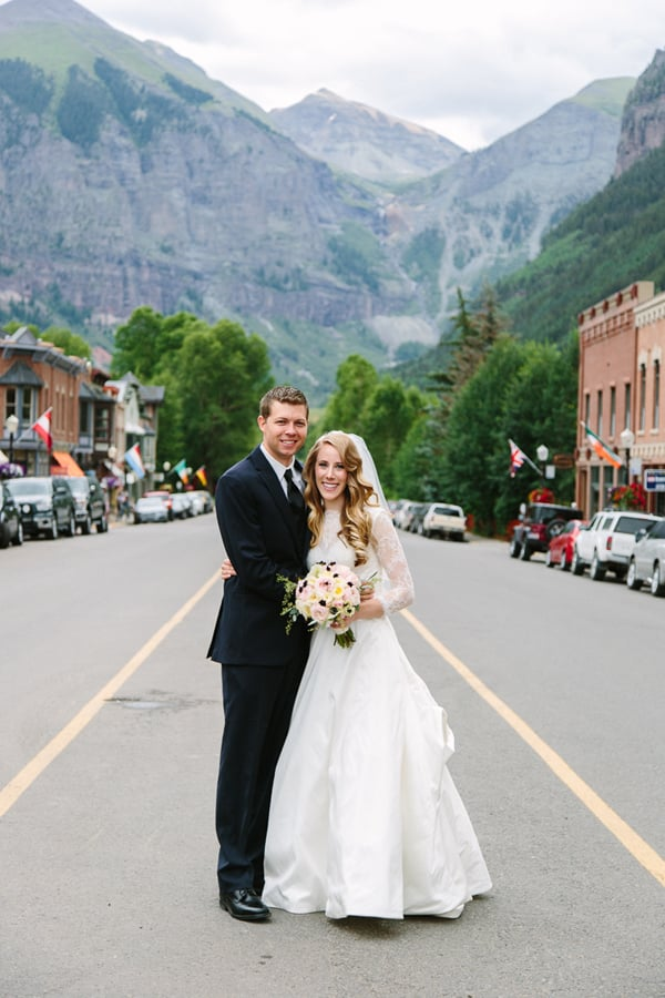 Bride and groom with Bridal Veil Falls in background | Telluride, Colorado wedding | Cat Mayer Studio
