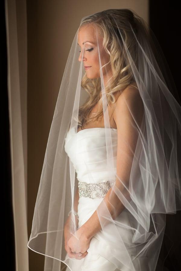 Bride under veil standing at window | Telluride wedding | Photographer Cat Mayer Studio
