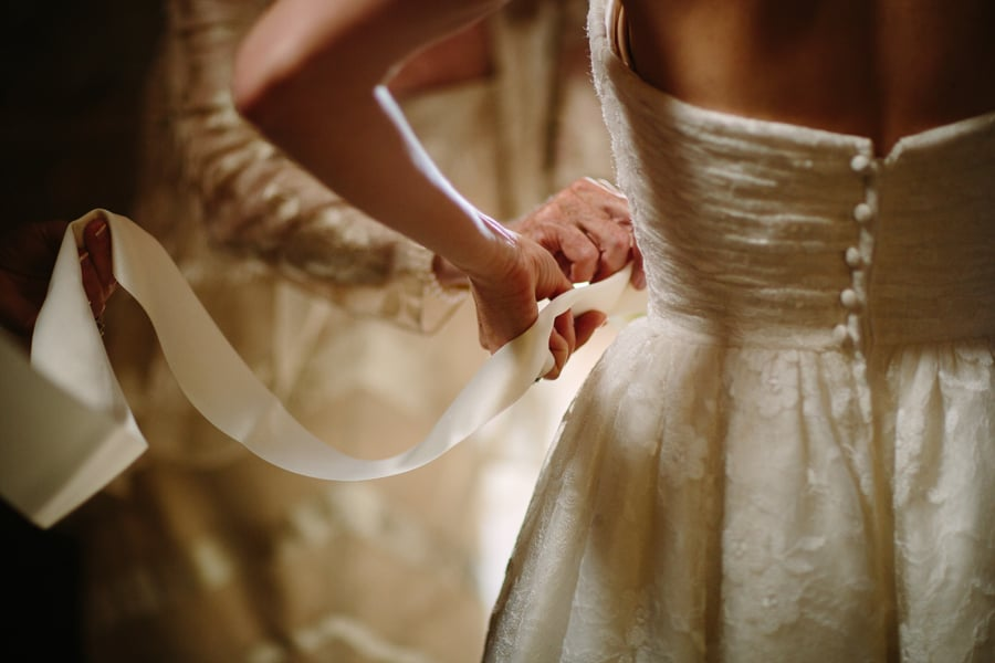 Bride putting on dress | Gorrono Ranch Saloon, Telluride | Cat Mayer Studio