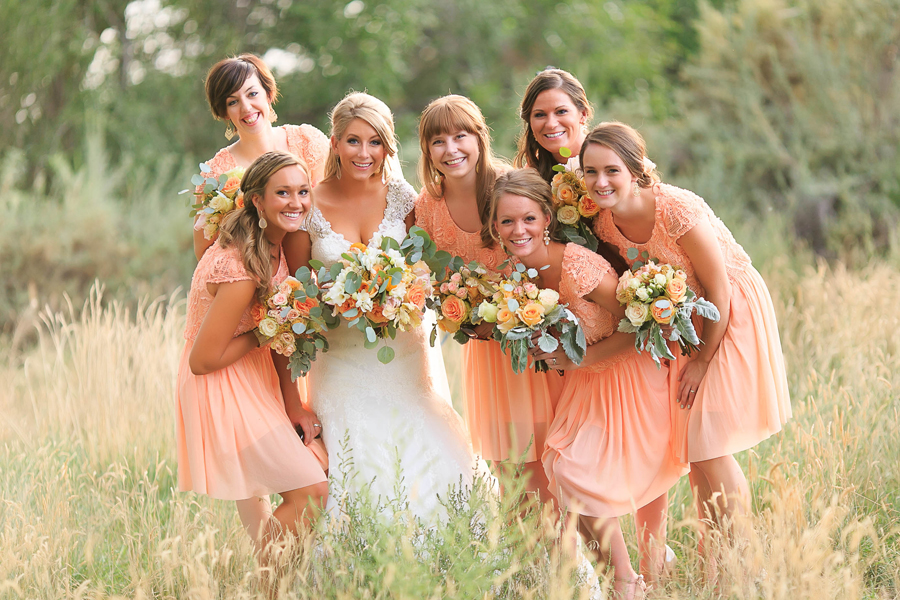 Bride with bridesmaids | Peach dresses and wedding flower bouquets by 3 Leaf Floral | Grand Junction Wedding Photography by Cat Mayer Studio | www.catmayerstudio.com