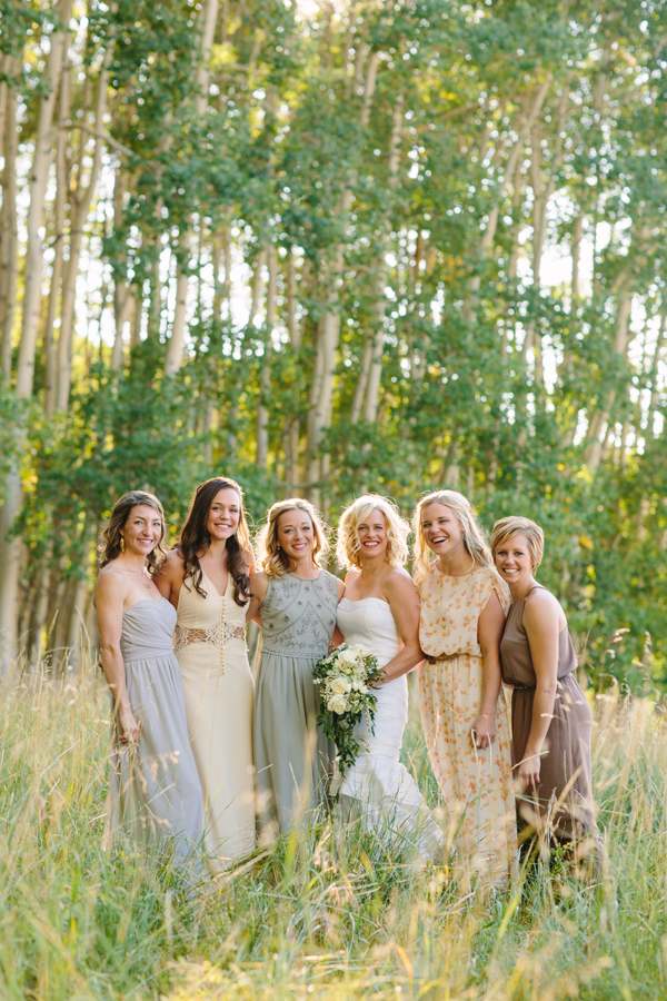 Bride with mismatched non-matching bridesmaids dresses | Aspen wedding | Photography: Cat Mayer Studio www.catmayerstudio.com