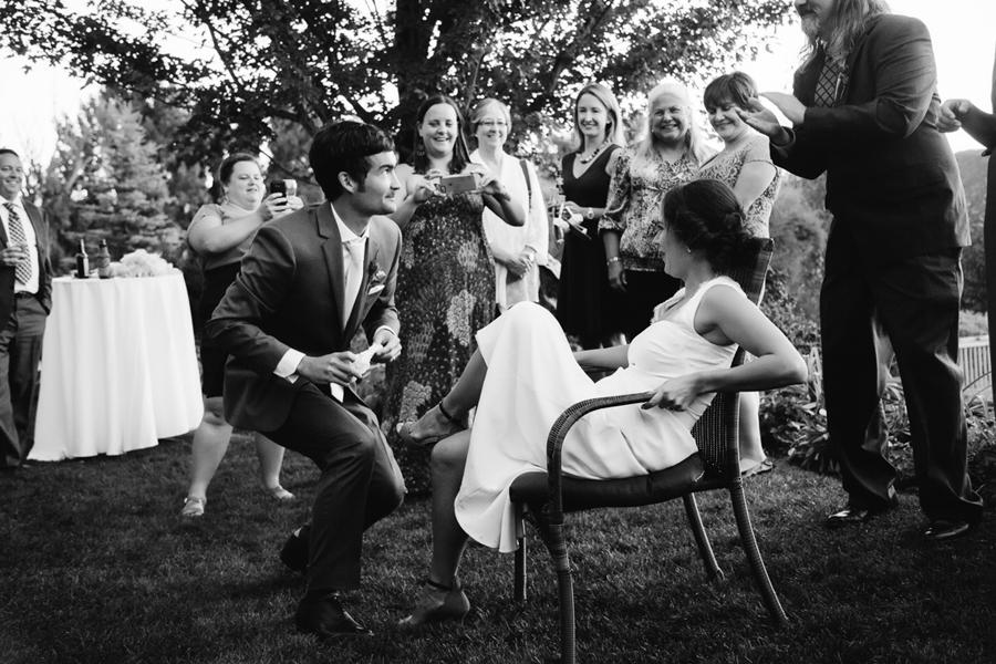 Garter toss | Candid photo at Aspen Wedding | Photographer: Cat Mayer Studio www.catmayerstudio.com