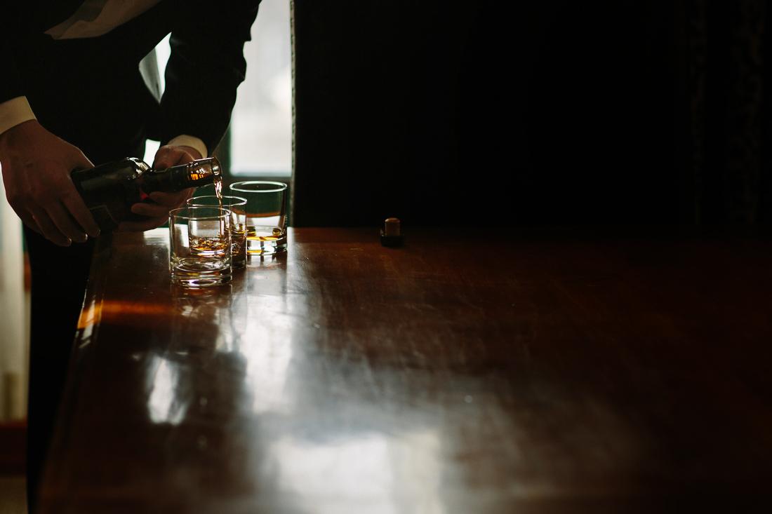 Park Hyatt Beaver Creek Wedding | www.catmayerstudio.com | Groom pouring whiskey