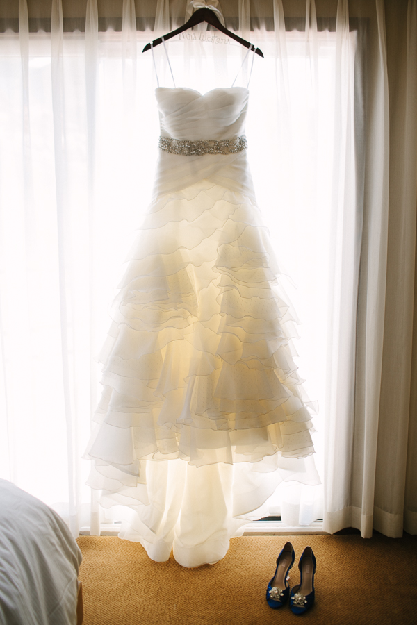 Cat Mayer Studio | www.catmayerstudio.com | San Sophia Telluride Wedding | Wedding dress hanging in window