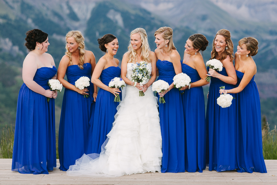 Cat Mayer Studio | www.catmayerstudio.com | San Sophia Overlook wedding party portraits | Telluride, Colorado | Bride and bridesmaids in blue dresses laughing