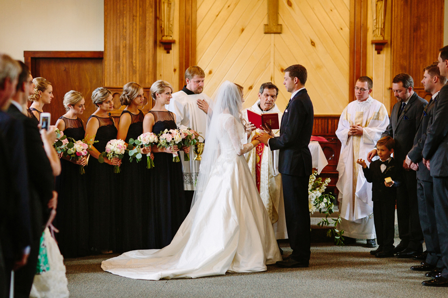 Couple speaking wedding vows  | St. Patrick's Catholic Church , Telluride | Cat Mayer Studio | www.catmayerstudio.com
