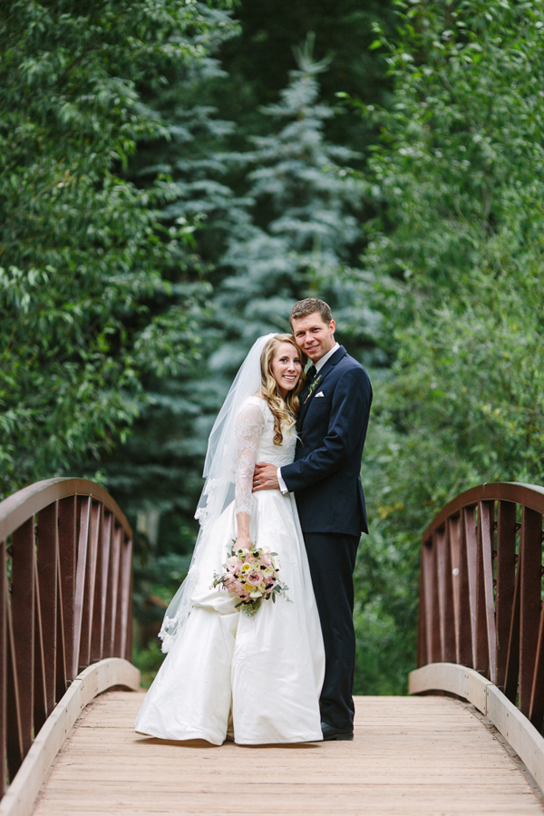 Bride and groom wedding portrait on bridge | Telluride Town Park | Cat Mayer Studio | www.catmayerstudio.com