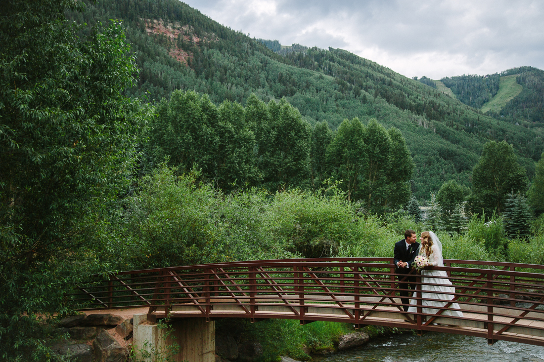 Wedding couple on bridge at Town Park in Telluride | Cat Mayer Studio | www.catmayerstudio.com