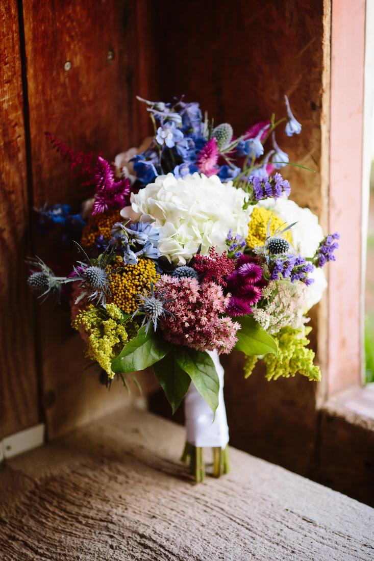 Aspen Wedding Photography | Red Blue Yellow and White Bouquet | Cat Mayer Studio | www.catmayerstudio.com