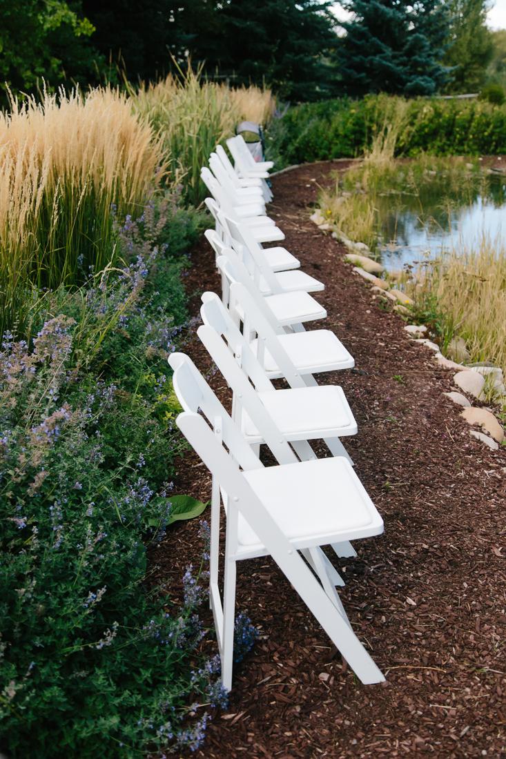 Row of White Chairs Outside | Cat Mayer Studio | www.catmayerstudio.com