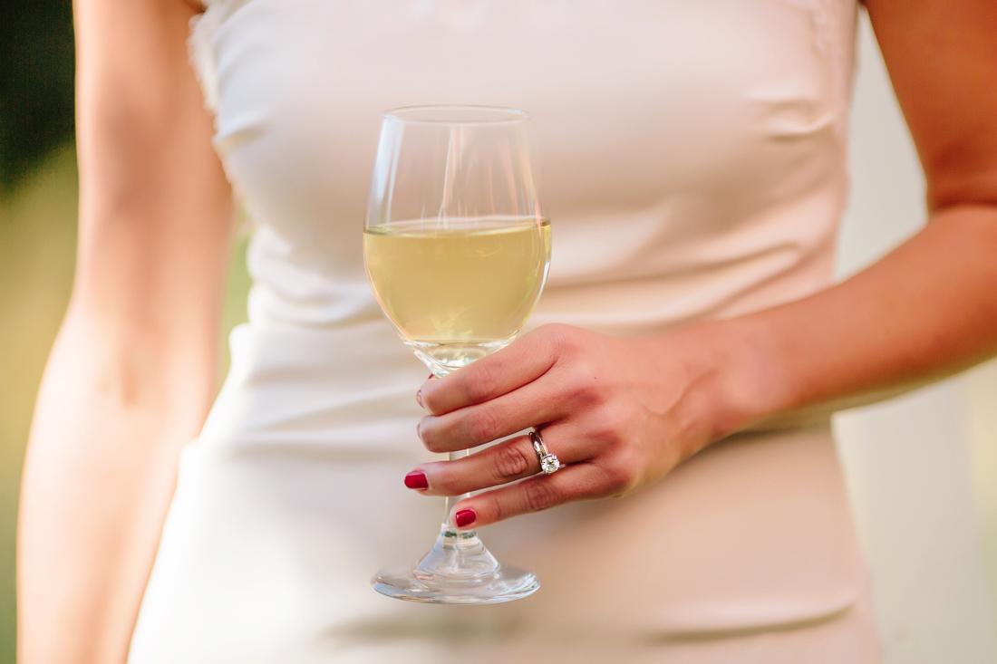 Aspen Wedding Photography | Bride with a Glass of White Wine and Wedding Ring | Cat Mayer Studio | www.catmayerstudio.com