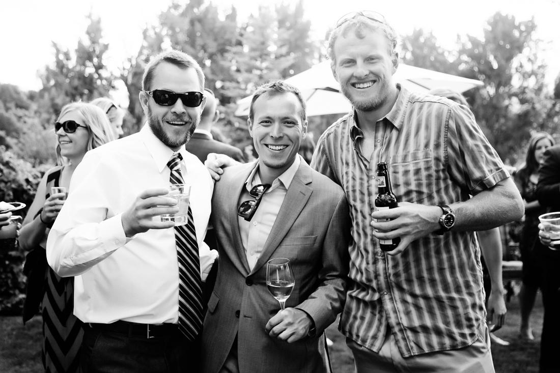 Black and White Photo of Wedding Guests Smiling | Cat Mayer Studio | www.catmayerstudio.com