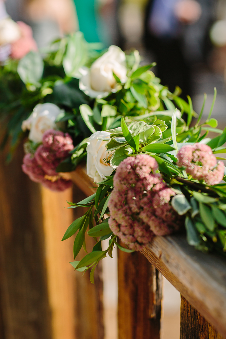 Red Green and White Flowers Wrapped Around Railing| Cat Mayer Studio | www.catmayerstudio.com