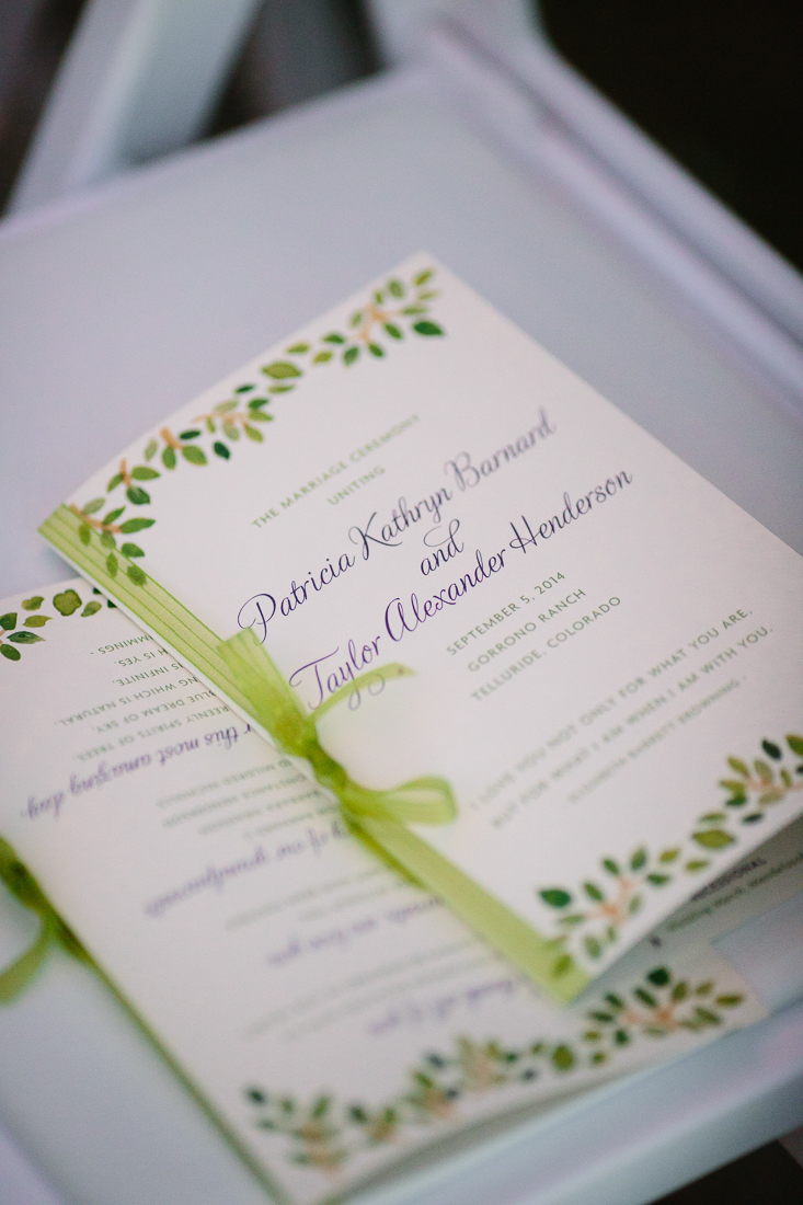 Wedding Brochure with Green Ribbon | Photography by Cat Mayer Studio | www.catmayerstudio.com