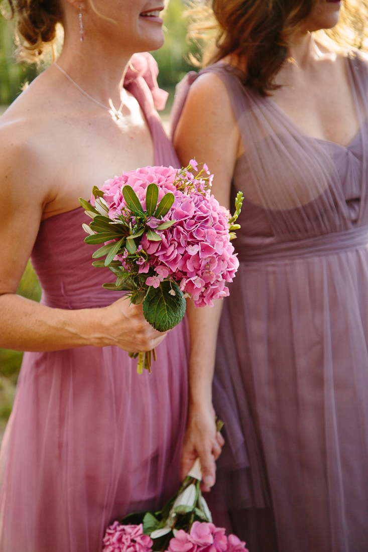 Bridesmaids with Rustic Pink and Purple Dresses Holding Pink Flowers | Cat Mayer Studio | www.catmayerstudio.com