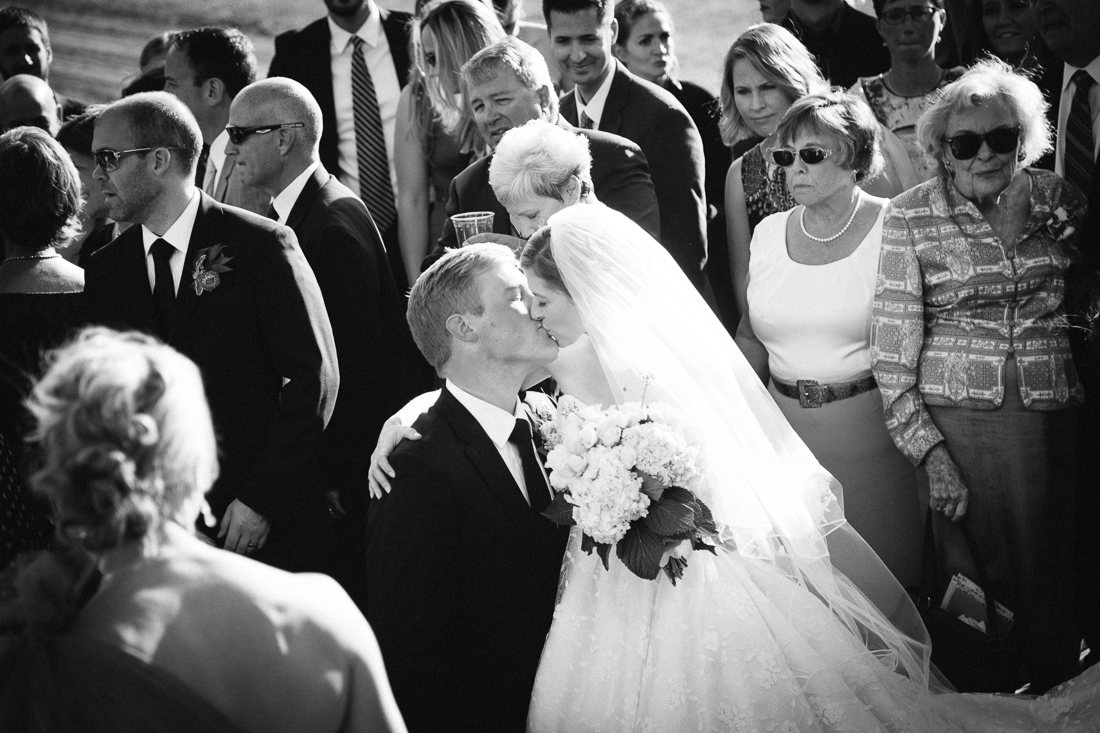 Black and White Photo of Wedding Couple Kissing | Cat Mayer Studio | www.catmayerstudio.com