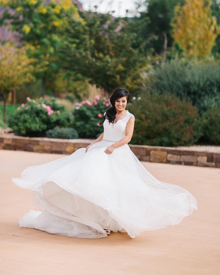 Bride Twirling in Long Ballgown Wedding Dress | Cat Mayer Studio | www.catmayerstudio.com