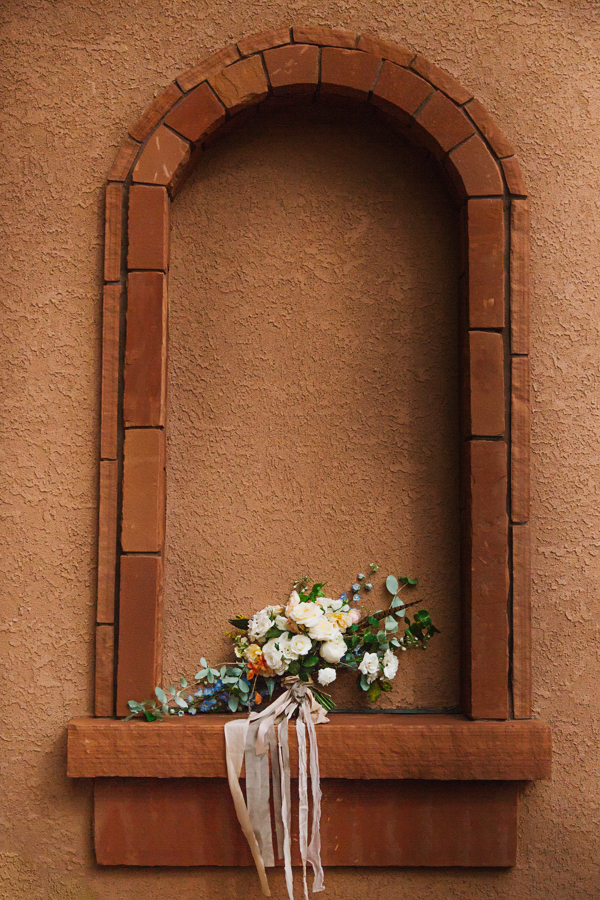 Colorful Bouquet with Long Ribbon Placed in Stone Window | Cat Mayer Studio | www.catmayerstudio.com