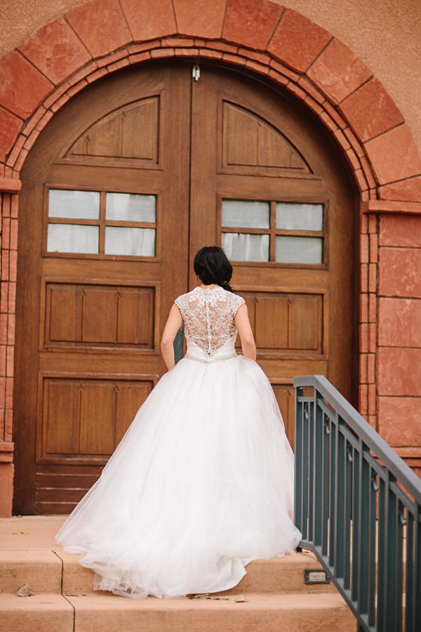 Gateway Wedding Photography | Bride Walks Up Stone Stairs in Gateway Colorado | Cat Mayer Studio | www.catmayerstudio.com
