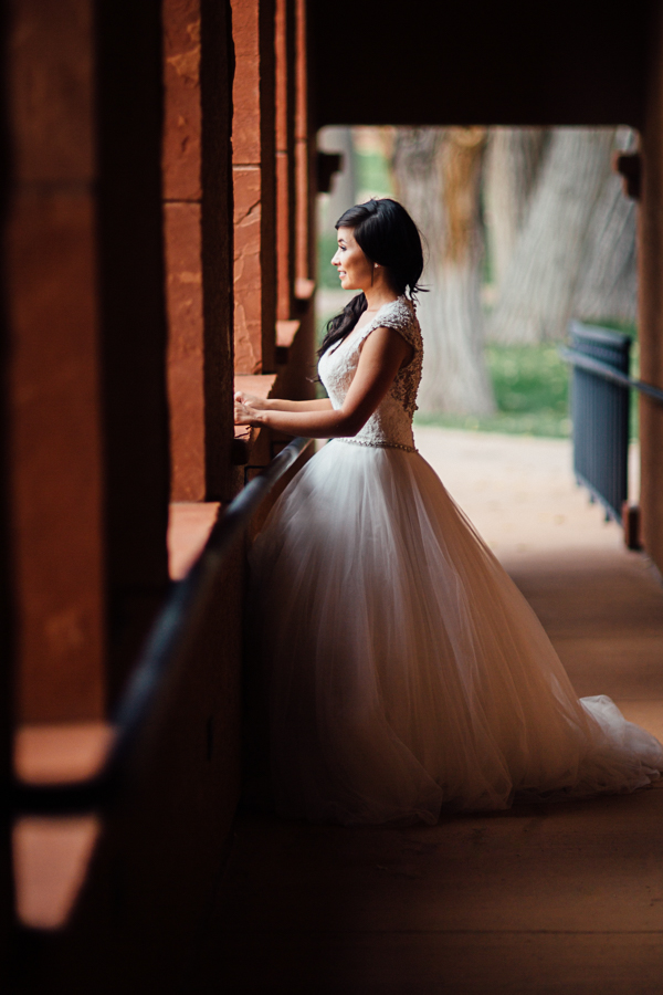Bride Looks out at Gateway Scenery | Cat Mayer Photography | www.catmayerstudio.com