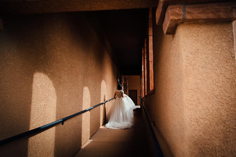 Gateway Canyons Wedding Photography | Bride Walks Through Stone Hallway | Cat Mayer Photography | www.catmayerstudio.com