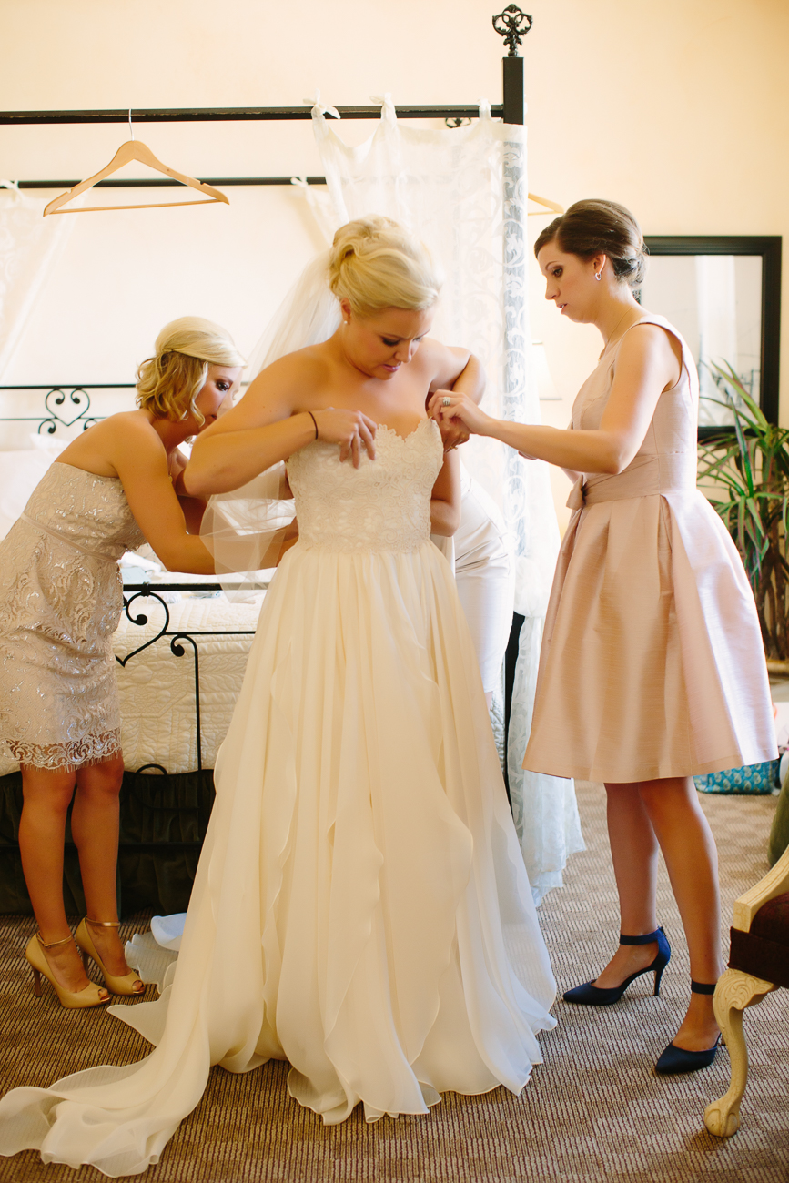 Mother and Sister Help Bride Into Wedding Dress | Cay Mayer Photography | www.catmayerstudio.com