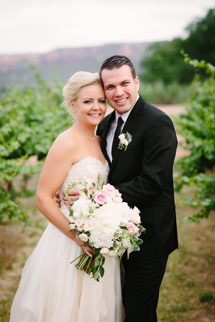 Two Rivers Wedding| Wedding Couple Posing in Vinyard | Cay Mayer Photography | www.catmayerstudio.com