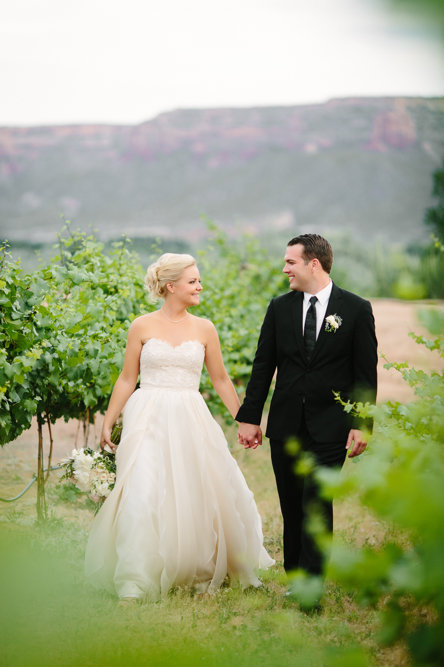 Newlyweds Hold Hands at Two Rivers Winery | Cay Mayer Studio | www.catmayerstudio.com