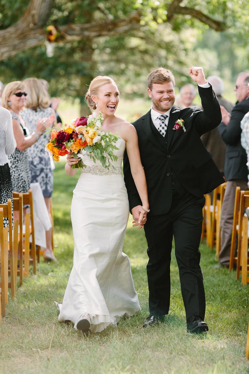 Bride and groom walking down aisle at Aspen wedding