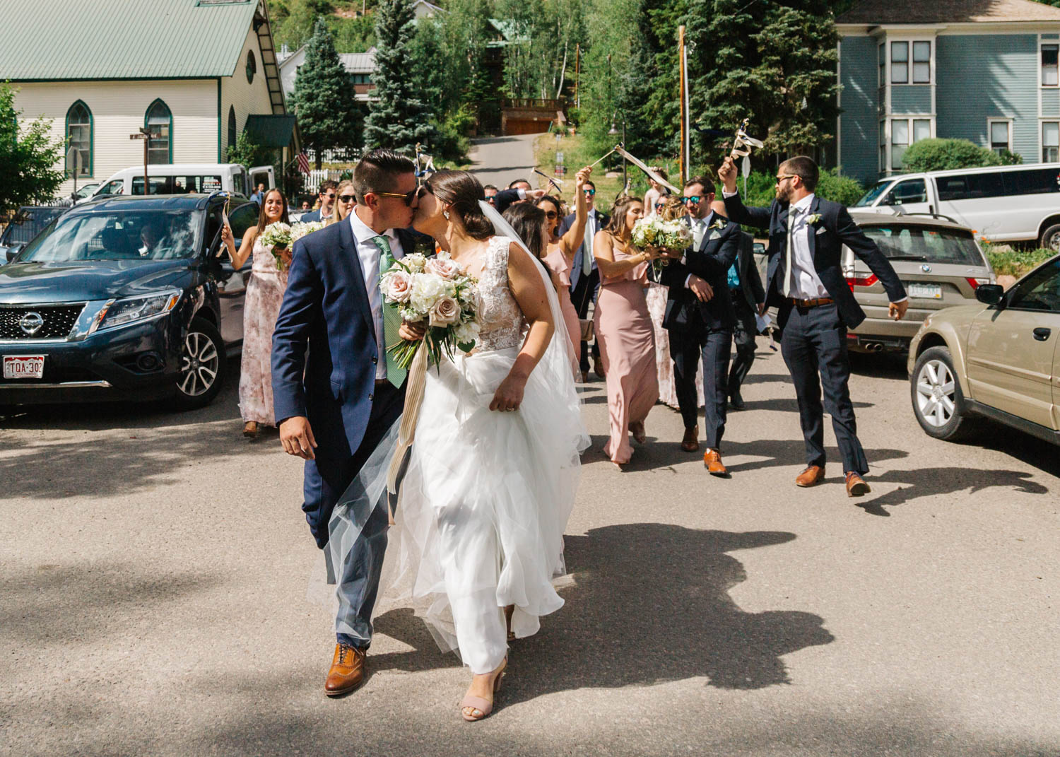 Bride and Groom leading wedding parade through town