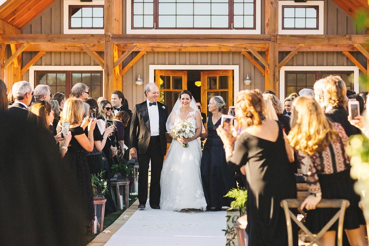 Bride+walking+down+aisle+at+Chaparral+Ranch