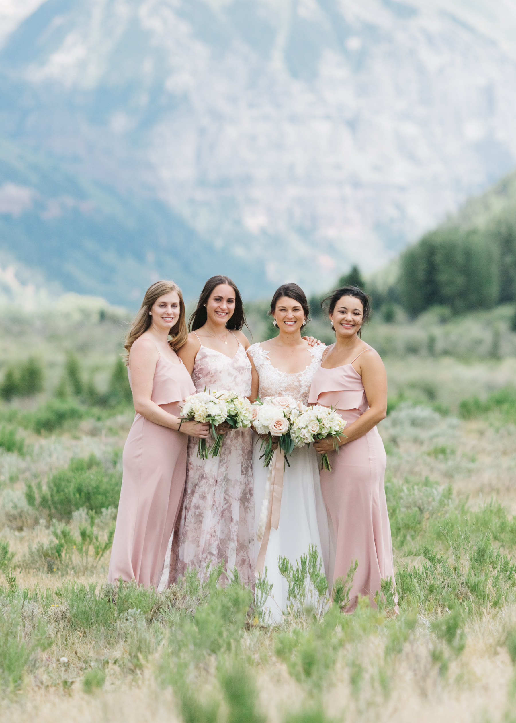 Destination wedding in Telluride Colorado, with ceremony at St. Patrick's Catholic Church and reception at Gorrono Ranch. First look at Valley Floor and the entire wedding paraded through Telluride's Main Street (Colorado Ave.)