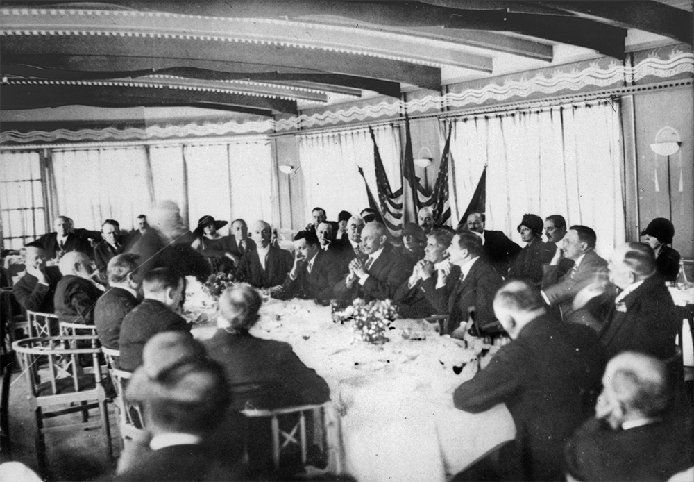 Bernays represented the U.S. at the International Exposition of Modern Decorative and Industrial Arts in 1925 (Bernays is seated near the center, his right hand at his face).