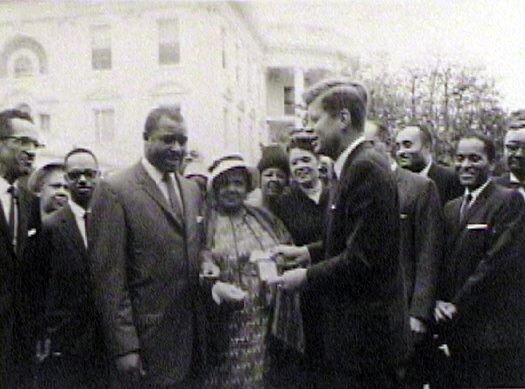 Moss Kendrix (at right, hands clasped)was among a group of newsmen and women to meet the president in the rose garden