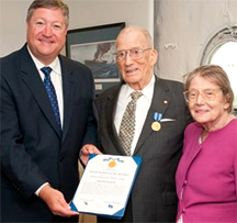 Secretary of the Air Force Michael Donley (left) presented Chester Burger (center) and his wife Elisabeth (right) the Air Force Distinguished Public Service Award Aug. 24, 2010, for his service as an Air Force advocate under the Public Affairs Advisory Group in New York City for more than 15 years. (U.S. Air Force photo/Lance Cheung)
