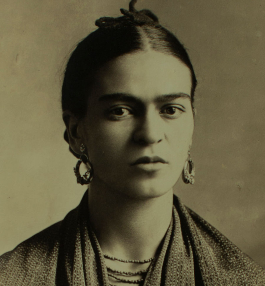 Frida Kahlo, a bisexual feminist Hispanic artist who was both iconic and outspoken about her identity and her paintings. She is known for many works, one of which is a self-portrait where she makes prominent her unshaved eyebrows to challenge feminine standards.