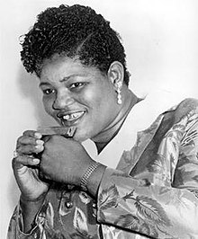"Willie Mae ""Big Mama"" Thornton, a black queer lesbian singer who, though often attacked by critics, challenged the traditional expectations of female singers by wearing traditionally masculine clothing. She later went on to write ""Hound Dog,"" which would later become one of Elvis Presley's biggest hits."