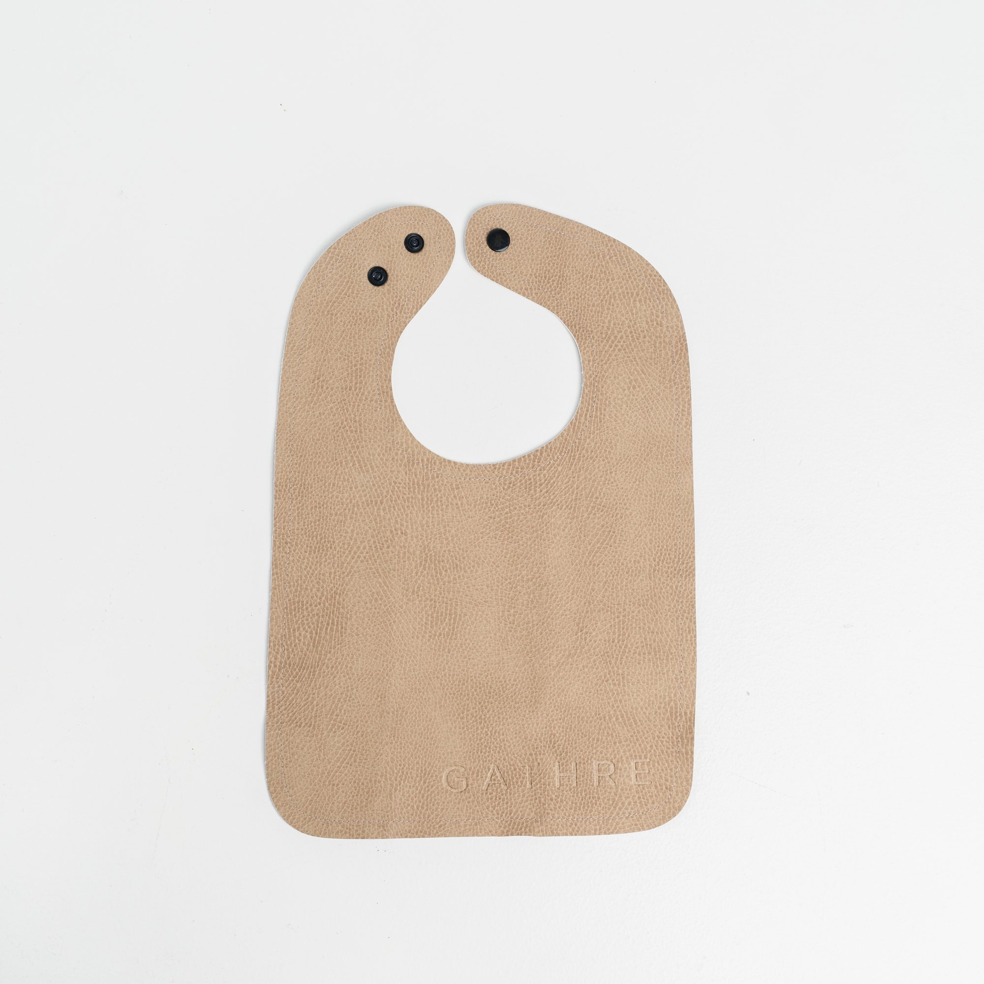 Gathre Toddler Bib Bib Regular price$14.00 Pretty meets practical with our wipeable vegan leather bibs
