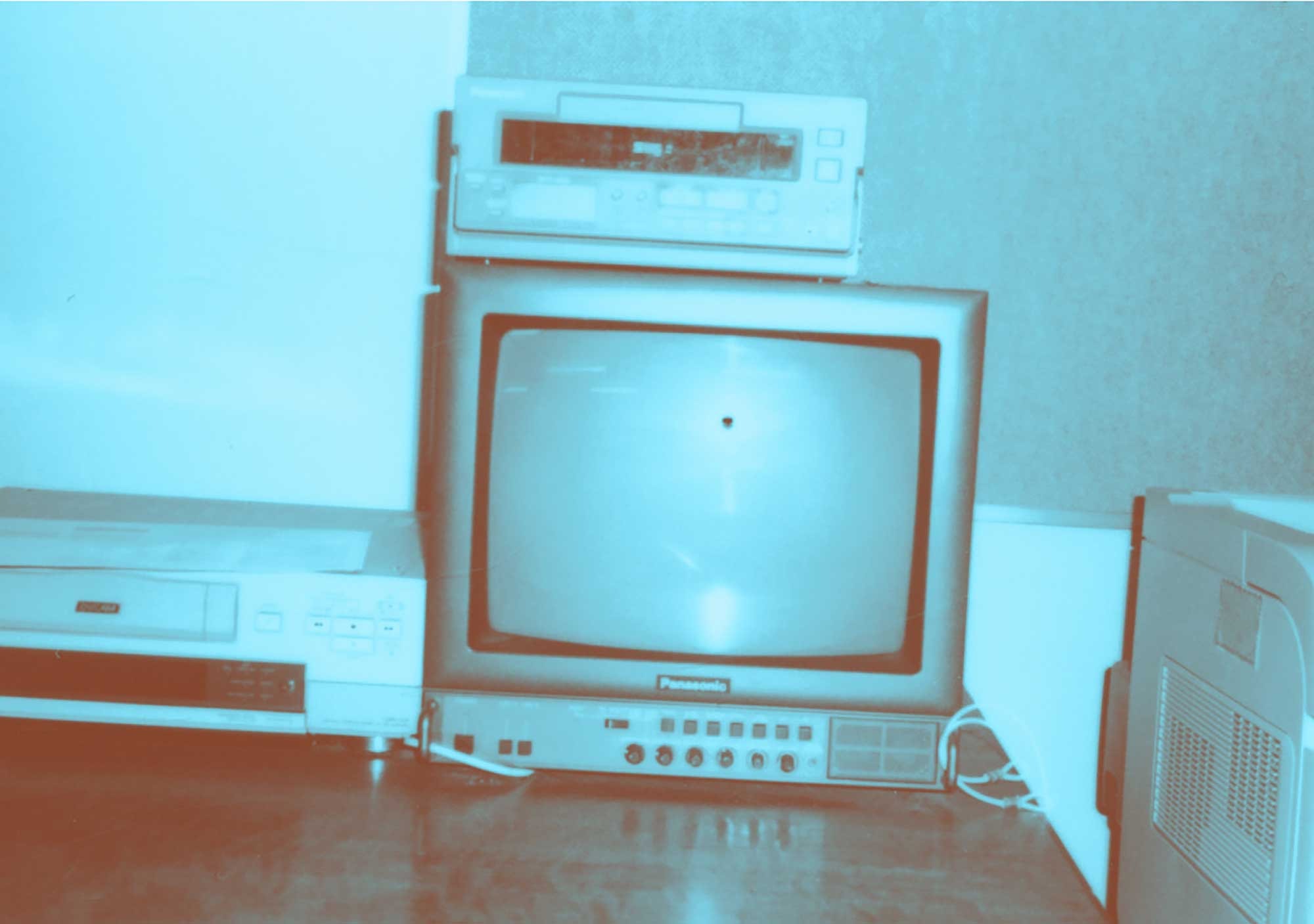 Image of a blank TV, a DVD player and video player.