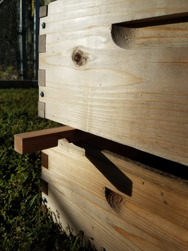 Use an entrance reducer as a sort of wedge to help as you remove upper hive bodies.